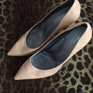 """Tan pumps with 4"""" silver stiletto heels."""